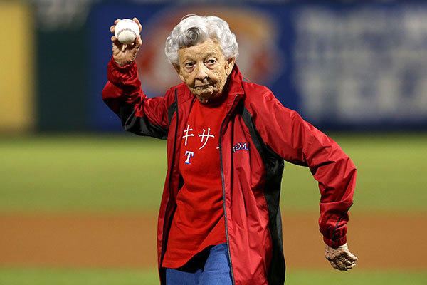 Sister Frances Evans throws out the ceremonial first pitch prior to the Texas Rangers hosting the Baltimore Orioles during the American League Wild Card playoff game  at Rangers Ballpark in Arlington on October 5, 2012 in Arlington, Texas.