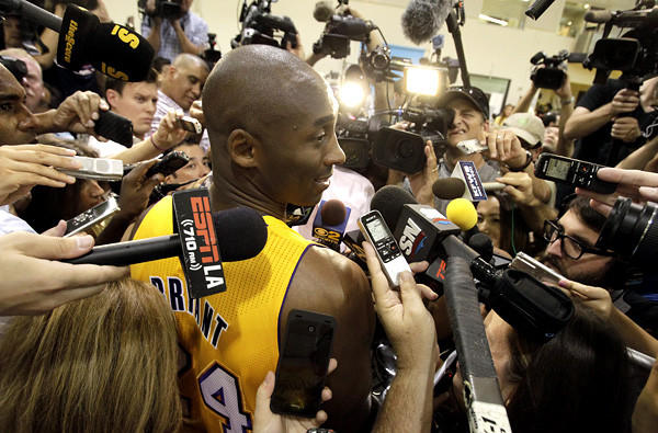Kobe Bryant is swarmed by reporters during media day.