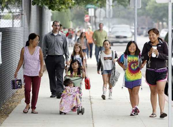 Parents and caretakers walk their kids to school along Oak Street on Walk to School Day at Stevenson Elementary School in Burbank. PTA president Jennifer Esperson said she was blown away by the success of Walk to School Day.