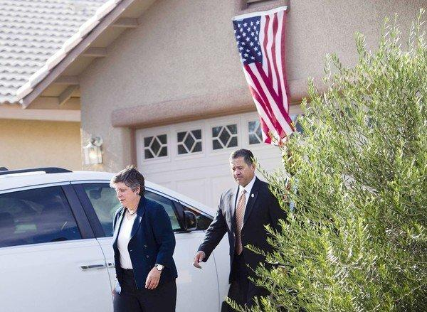 Homeland Security Secretary Janet Napolitano and Border Protection Deputy Commissioner David Aguilar leave a home in Sierra Vista, Ariz., after offering condolences to the family of slain Border Patrol Agent Nicholas Ivie.