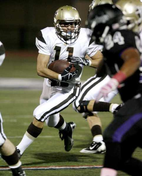 St. Francis' Daniel Kawamura runs the ball against Cathedral.