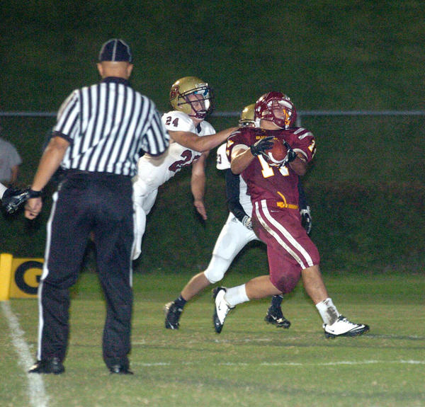 Garrard County's Garett Caudill is hit as he catches an 18-yard touchdown pass from Bill Abney in the first quarter of Friday's 28-8 loss to Bourbon County.