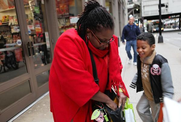 """""""I know it's in here … I think,"""" said Molina as she checked her two coat pockets, then various zippered pockets in her shoulder bag.<br> <br> """"Come on, Mom. Come on. Come on,"""" cheered her son, Mateo, 7, jumping up and down as she struggled to locate the phone for what seemed a very long time.<br> <br> Molina says she just tosses the phone into her purse """"at random"""" which is why it took her the longest of all those I interviewed — 16 (and 1/2) seconds — to locate the phone.<br> <br> """"At least I found it,"""" she laughed."""
