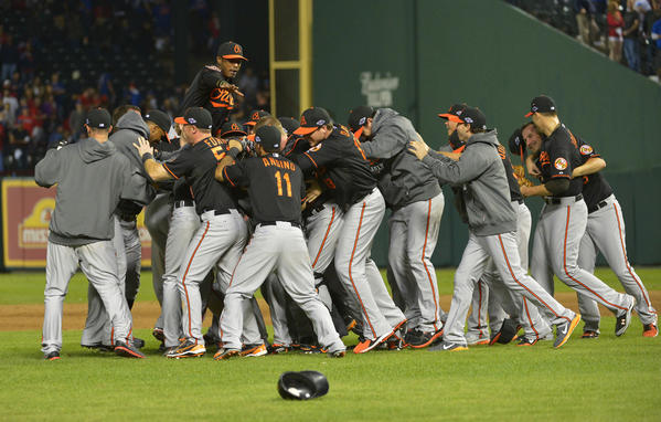 The Baltimore Orioles celebrate a 5-1 win over the Texas Rangers in Wild Card playoff action at Rangers Ballpark in Arlington on Friday, October 5, 2012, in Arlington, Texas.