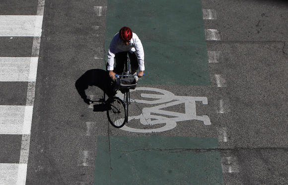 A bicyclist in the marked bike lane on West Kinzie at North Orleans Streets