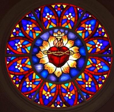 The Sacred Heart, a symbol of Jesus' suffering, forms the centerpiece of the rose window at Heart of Jesus Maronite Catholic Church in Fort Lauderdale.