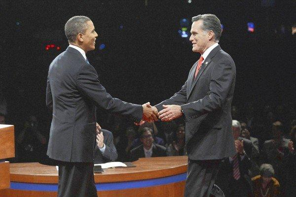 President Barack Obama and Republican contender Mitt Romney greet each other ahead of the first presidential debate Wednesday in Denver.
