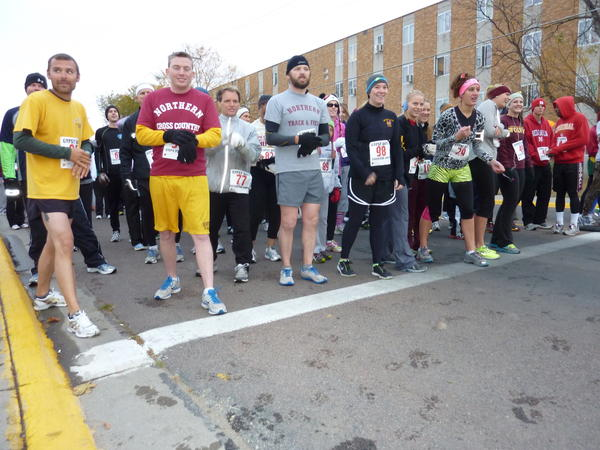 Runners wait for the start of the Steps for Shep 5K at 8:01 a.m. Saturday on South State Street near Jerde Hall.