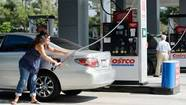 Customers gas up their cars at Costco Wholesale Corp. in Burbank, Calif.