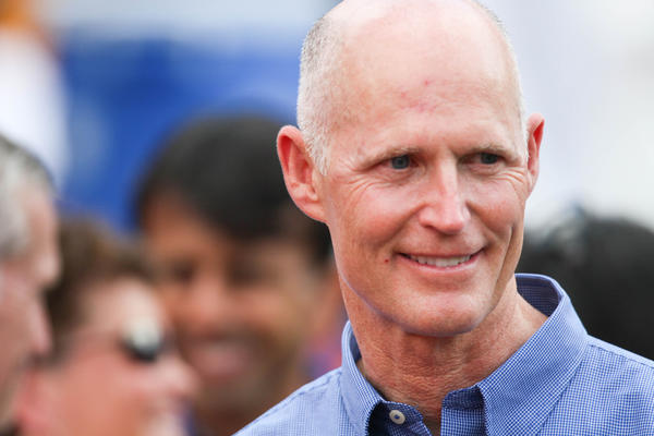 Florida governor Rick Scott greets fans before the start of Florida's game against Louisiana at Ben Hill Griffin Stadium on Saturday, October 06, 2012 in Gainesville, FL.