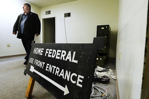 County Adminstrator Greg Murray walks thru the basement  at the former Home Federal and  PNC Bank next to the County Adminstration offices on W. Washington St.