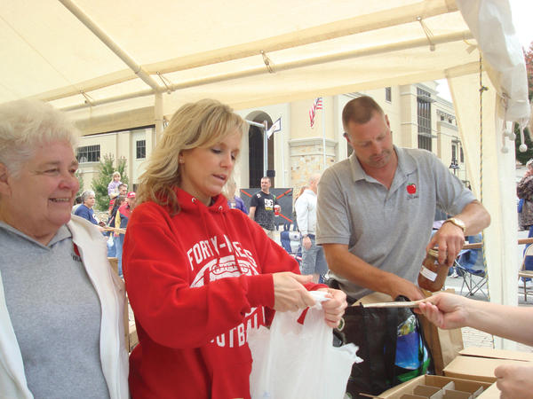 From left, Margie Starliper, Gretchen Munson and Tim Fox, members of the Pleasant View Community Center Association, handle apple butter sales Saturday at the 39th annual Apple Butter Festival in Berkeley Springs, W.Va.