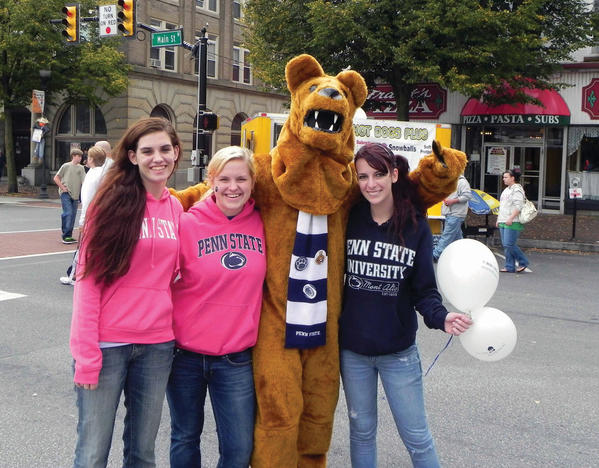 Kiersten McCartney, Charlie Tuttle, the Nittany Lion and Emily Deshong spread the Penn State spirit Saturday at the eighth annual Market Day in Waynesboro, Pa.