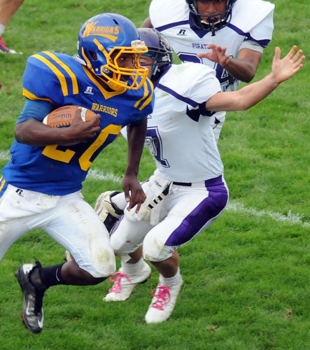 Wilson's Trey Robinson (20) runs the ball past Palisades' Jesse Snyder (7) during their game on Saturday at Wilson Area High School stadium.