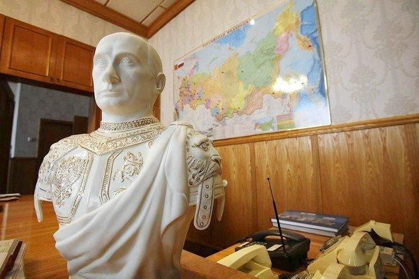 A bust of Russian President Vladimir Putin clad as a Roman emperor sits on the desk of a Moscow businessman who depends on the government for his contracts.