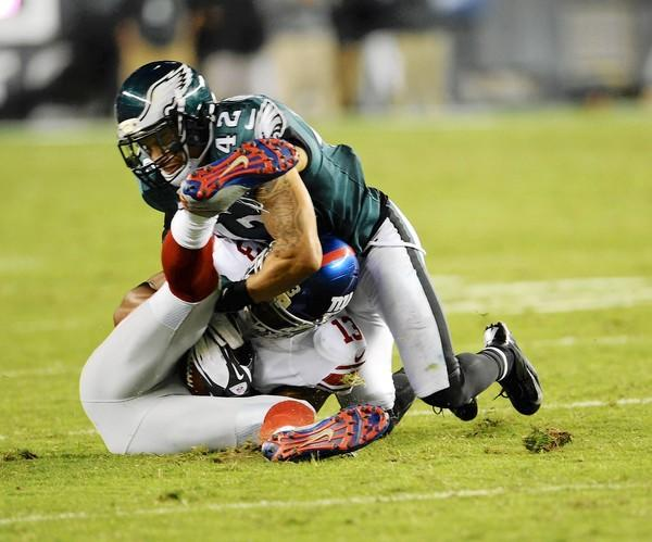 Eagles free safety Kurt Coleman, known for his fierce hitting despite a lack of size, wraps up Giants receiver Ramses Barden in last Sunday night's game at Lincoln Financial Field.
