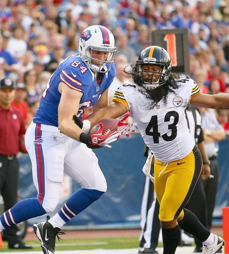 Troy Polamalu #43 of the Pittsburgh Steelers reaches in to break up a pass intended for Scott Chandler #84 of the Buffalo Bills at Ralph Wilson Stadium on August 25, 2012 in Orchard Park, New York.