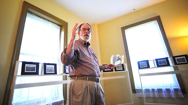 "Pulitzer Prize-winning journalist Henry Allen spoke Saturday at the Pry House Field Hospital Museum at Antietam National Battlefield about the Civil War photographs of Alexander Gardner. Reproductions of those images are part of an exhibit there titled, ""Bringing the Story of War to Our Doorsteps."""