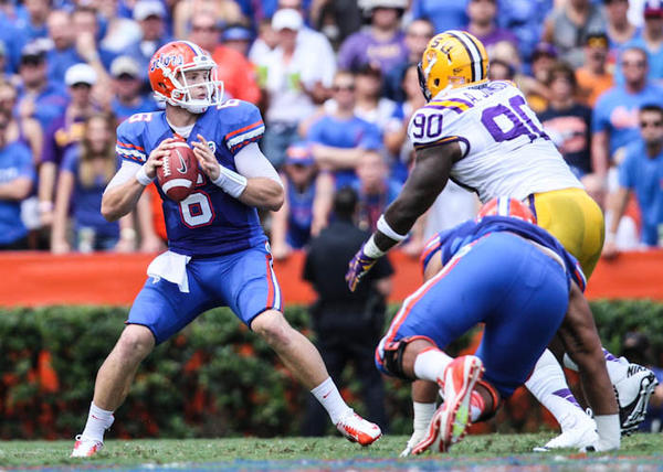 Florida quarterback Jeff Driskel (6) gets pressured by LSU's Anthony Johnson (90) during first quarter action of their game against LSU at Ben Hill Griffin Stadium on Saturday, October 06, 2012 in Gainesville, FL.