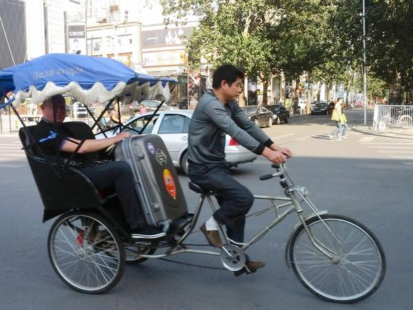 A bicycle rickshaw driver near Ritan Park in Beijing.