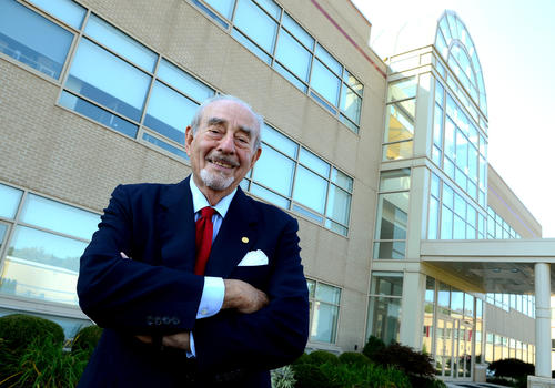 Lutron Electronics founder Joel Spira poses outside one of the buildings on his company's Upper Saucon Twp. campus.