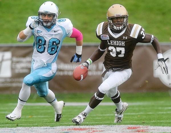 Lehigh's Bryan Andrews (right) returns an interception in front of Columbia's Louis DiNovo (left) during their football game at Goodman Stadium Saturday afternoon.
