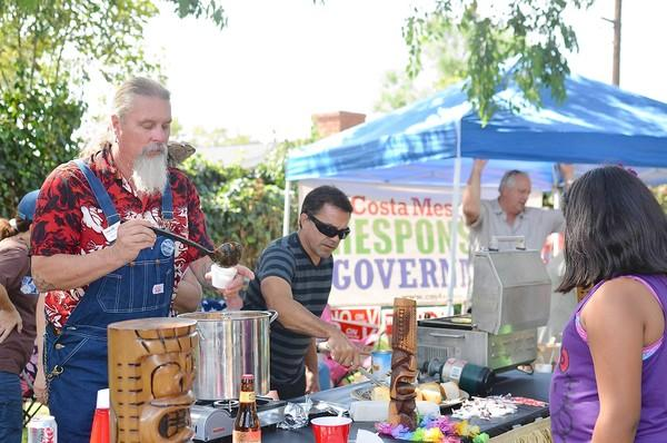 Billy Folsom, member of the Costa Mesa City Employees Assn., serves Hawaiian-inspired chili at the Halecrest Community Chili Cook-off on Saturday.