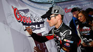 Kasey Kahne has won the pole at Talladega Superspeedway, the fourth race in NASCAR's Chase for the Sprint Cup championship.