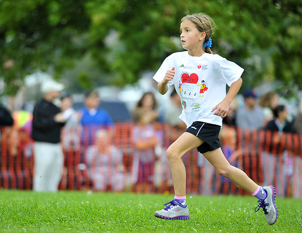Williamsport Elementary's Erica Keplinger sprints to the finish line on Saturday to win the fourth grade girls race during the 31st annual Washington County Public Schools Elementary Cross Country Run.