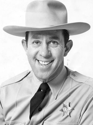 "John Rovick donned a sheriff's hat, khaki uniform and badge to become Sheriff John on KTTV's daily ""Cartoon Time"" show."