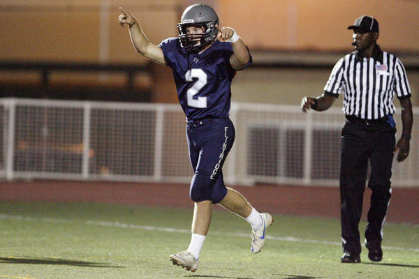 Flintridge Prep's Kurt Kozacik points to the crowd after making a touchdown during a game against Chadwick at La Canada High School on Saturday, October 6, 2012.