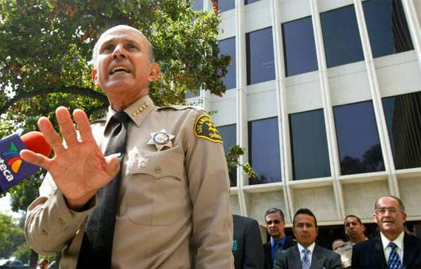 L.A. County Sheriff Lee Baca addresses the media outside the Sheriff's headquarters in Monterey Park, respondin