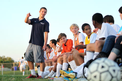Marriotts Ridge's Pat Moore, left, talks to his teammates during the boys soccer game against Howard.