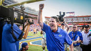 "<b>Video:</b> Gators coach Will Muschamp does ""Ooh-Ah!"" LSU victory dive into players' arms"