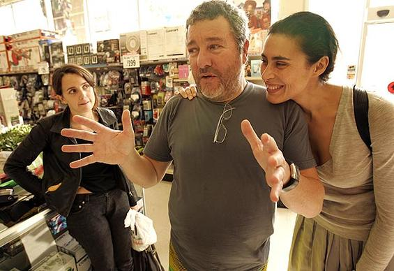 "Famed designer Philippe Starck, his wife, Jasmine, right, and daughter Ara go shopping at a Big Lots store in Hollywood to show how far a dollar can go in recessionary times. ""In a time of financial crisis, we must go back to timeless objects and rediscover the elegance of basics,"" says Starck, the"