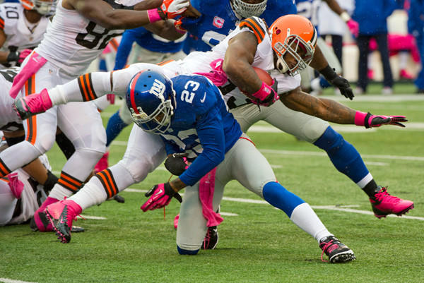 Cleveland Browns Trent Richardson is brought down by New York Giants Corey Webster on Oct. 7.