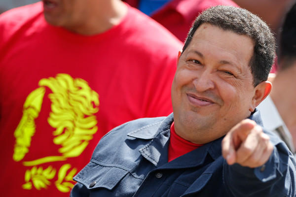 Venezuela's President Hugo Chavez gestures as he arrives to cast his vote for the presidential elections in Caracas.