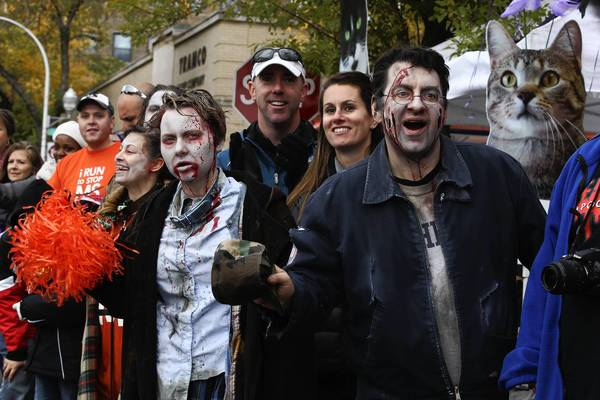 Fans dressed as zombies gather at Adams near Loomis to cheer on runners during the Chicago Marathon.