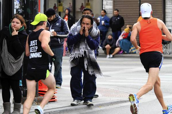 The streets of the Pilsen neighborhood in Chicago are filled with runners and cheering spectators, like Leo Ramirez, at mile 19 of the Bank of America Chicago Marathon.