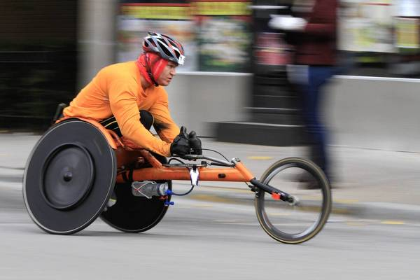 The streets of the Pilsen neighborhood are filled with wheelchair racers, runners and cheering spectators at mile 19 of the Bank of America Chicago Marathon.