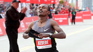 Kebede wins Chicago Marathon in course-record 2:04:38