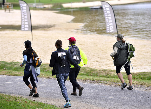 A team of competitors run to the next challenge Sunday during the Buff Betty Woman's Only Adventure Race at Greenbrier State Park.