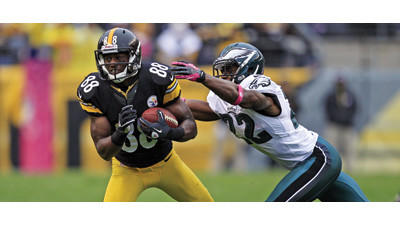 Pittsburgh Steelers wide receiver Emmanuel Sanders runs after catching a pass from as Philadelphia Eagles cornerback Brandon Boykin makes the tackle on Sunday.