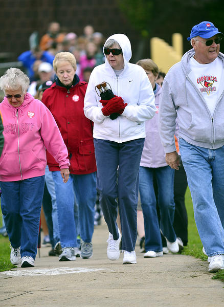 Several dozen people step off for the CROP Hunger Walk Sunday during the annual Waynesboro (Pa.) YMCA Fun Day.