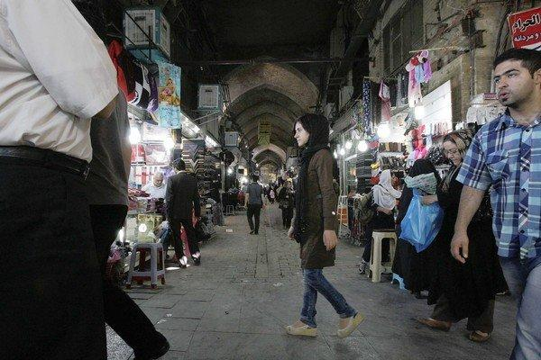 Iranians shop at the old main bazaar in downtown Tehran. More police officers have been patrolling the bazaar, sending a message that further acts of public defiance will not be tolerated.