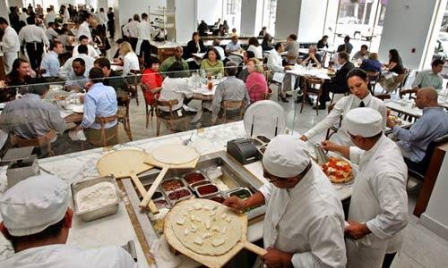 Pizzas are made for the lunch crowd at Bottega Louie in downtown Los Angeles. The kitchen gets the food out fast, which is why the Italian restaurant can feed hundreds of diners on a weekend night.