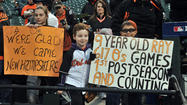 After 15 years of waiting for playoff baseball at Camden Yards, Orioles fans had to endure an extra 21/2 hours as chilly rain pushed back the start of Sunday's division series opener against the hated New York Yankees.