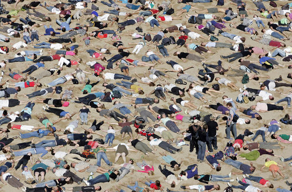 People take part in the filming of a clip at a beach in Oostende