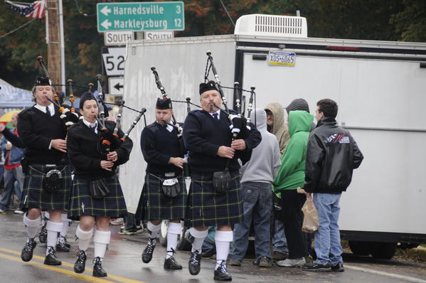 The New Haven Hose performed a lively number on bagpipes and other instruments wearing traditional Scottish kilts at the PumpkinFest Grand Feature Parade.