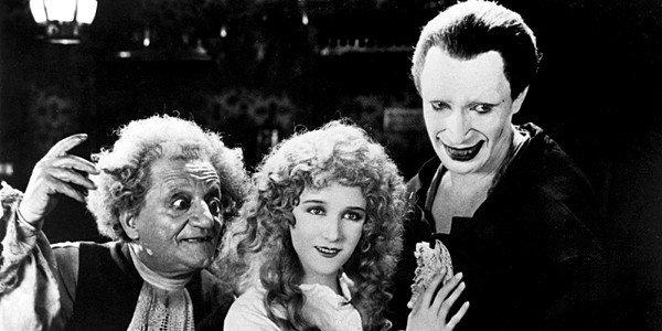 "Cesare Gravina, left, Mary Philbin and Conrad Veidt star in ""The Man Who Laughs."""